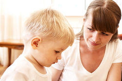 stock-photo-mother-talking-with-her-unhappy-son-at-home-53916214